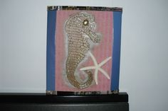 Cavalo-marinho reciclagem de papelão,tecido, semente de cafe e revista