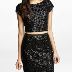 Express sequin two piece crop top and midi skirt Express black sequin crop top and midi skirt. Never worn. NWT. The skirt has a faux leather waist band. Top is size S and skirt is size 6. I would prefer to sell both pieces together but would be willing to sell separately as well. Incredibly chic for cocktail parties or prom! Express Dresses Midi