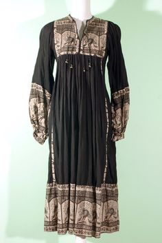 Black indian cotton dress with peacock pattern on it. On indiVintage.com