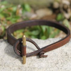 "Zoe bracelet in brass and chocolate leather, $35. A faceted stick acts as a toggle through a leather loop closure to close this thin leather bracelet. The juxtaposition of delicate and edgy gives the Zoe its unique look. Fits up to 6.5"" wrist."