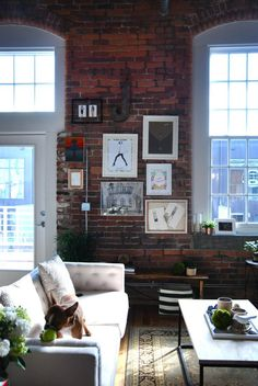 Brick wall and large windows for natural light