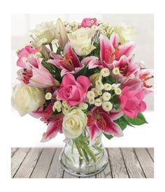 Send your love with a flower bouquet for your partner that is graceful and pretty. This is simply stunning with classic flowers such as roses and lilies. Flowers London, Flower Delivery Service, Send Flowers, Creative Cards, Ontario, Glass Vase, Arch, Bouquet, Lily