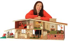 Mid century dollhouse.  My grandmother always cut out the Betsy McCall paper doll page from McCall's magazine and saved for me.  A fond memory.