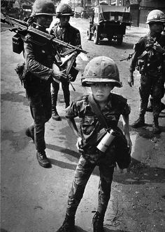 """Philip Jones Griffith - Ten year old South Vietnamese soldier. South Vietnam 1968. 'Called a """"little tiger"""" for killing two """"Vietcong women cadre"""" - his mother and teacher, it was rumored.' Nagasaki, Hiroshima, First Indochina War, Indochine, Vietnam War Photos, Vietnam History, Armed Conflict, Photo Vintage, South Vietnam"""