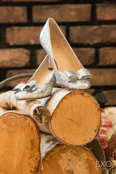 Gorgeous Kate Spade shoes sitting on top of the firewood captured by EXO Photography & Cinema.