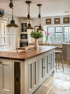 Farmhouse Touches — Love the lighting and counter tops in this...