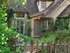 I love the rustic fence and garden elements. Yeah, the house is super awesome too - I could live there :)