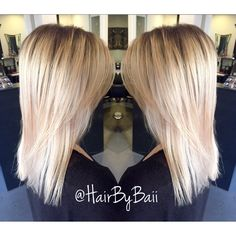 Blonde hair with root shadow. Blended blonde. Easy growout. All aveda color.