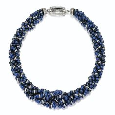 SAPPHIRE AND DIAMOND BEAD NECKLACE, CARTIER, CIRCA 1930. The five-strand necklace composed of numerous sapphire beads spaced at intervals by platinum and diamond rondelles, completed by a rectangular-shaped clasp flanked by a pair of double rings set with small round, single-cut and baguette diamonds, the clasp also accented in black enamel, mounted in platinum, length 17 inches, signed Cartier, numbered 2919649.