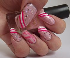 Pink breast cancer awareness manicure  Check out www.NailPolishIndieBrand.com as well.