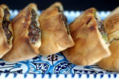 Egyptian Turnovers (hawawshi) With Pita Bread, Lean Ground Beef, Onions, Roma Tomatoes, Garlic, Chopped Parsley, Green Pepper, Cayenne Pepper, Spices, Crushed Red Pepper, Salt, Melted Butter