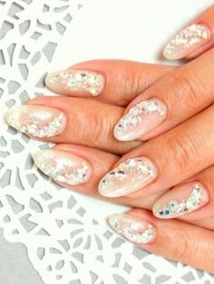 Bridal Nail Art inspirations - not sure how I feel about putting gems on my nails but for 1 day, I don't think I would mind as much.