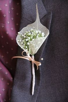 The Bride's father's Boutonniere of fresh Gypsophilia enveloped in a Skeleton Leaf the stem was bound with silver grey Ribbon and tied with a pale gold shoelace ribbon bow