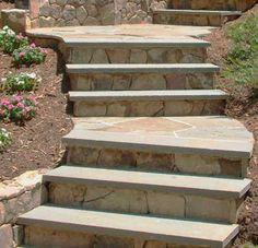 Bluestone steps with face stone risers... a beautiful curved outdoor staircase.