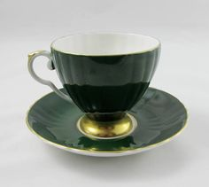 Green tea cup and saucer made by Royal Grafton. There is a gold rose on the inside rim of the tea cup and saucer. Gold trimming on cup and saucer edges. Excellent condition (see photos). Markings read: Royal Grafton Fine Bone China Made in England Please bear in mind that these are