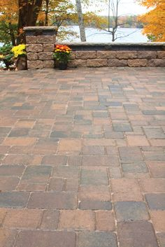 Willow Creek Cobblestone Pavers Add Rustic Elegance To A Lake Homeu0027s  Landscape.
