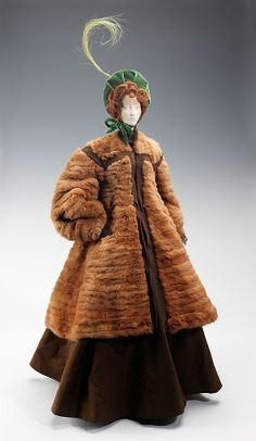 """""""1863 Doll"""" Weill (French) Designer: Jane Blanchot (French) Designer: Jean Clemént (French, 1900–1949) Date: 1949 Culture: French Medium: metal, plaster, hair, fur, feather, silk Dimensions: 32 x 11 1/2 in. (81.3 x 29.2 cm) Credit Line: Brooklyn Museum Costume Collection at The Metropolitan Museum of Art, Gift of the Brooklyn Museum, 2009; Gift of Syndicat de la Couture de Paris, 1949 Accession Number: 2009.300.717a, b"""