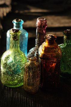 bohemian decor...Love colored glass bottles