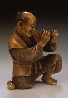 Sho (or Noboru?) (Japan)   Egg Tester, early 20th century  Netsuke, Ivory with dark staining, sumi, lacquer inlay