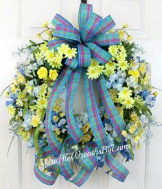 A personal favorite from my Etsy shop https://www.etsy.com/listing/508338828/blue-and-yellow-spring-wreath-on