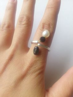 adjustable silver ring with black and white beads