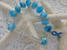 Blue Beads Sideways Cross Blue Ribbon Colon by CaseyRoseCollection, $16.00