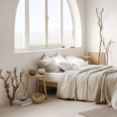 Striped Linen Bedding Semi-circle window, wooden night stand, wooden stool, neutral colours #bedroomdecor