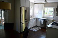 Small kitchen reno with Silestone Lagoon, white cabinets, stainless appliances