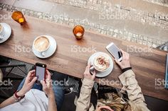 Cappuccino served on a cafe table in Copenhagen - Denmark royalty-free stock photo