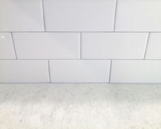 right quartz for us but ultimately we found LG Viatera Quartz in Cirrus was our winner! Our decision for our backsplash was to keep it simple with the timeless look of white subway tile and a grey grout.