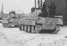 Several Panther Ausf G tanks at pause with the crews socializing.