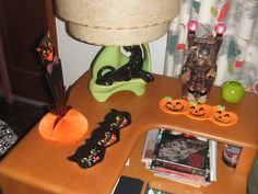 Some Halloween candy dishes and a Crypt Keeper animated figure.
