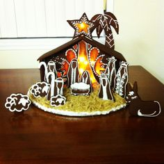 """My gingerbread nativity!  I had so much fun making this.  I drew out my design onto some card stock and """"laminated"""" each piece with shipping tape. I then laid the pieces onto the rolled out dough and cut around them with a butter knife.  Here's the link to the gingerbread recipe:   http://www.food.com/recipe/gingerbread-for-cookies-or-a-gingerbread-house-149257  Use blackstrap molasses to get the deep rich color.  The """"hay"""" is Shredded Wheat and the """"windows"""" are made of cooked sugar.  You…"""