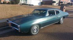1968 Pontiac LeMans. Just like my first car except mine had white interior.