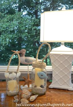 Wonderful and natural beach-themed lamps! Post includes lots of photos and instructions. Aren't these fun? from BetweenNapsOnThePorch: DIY Candle Lanterns