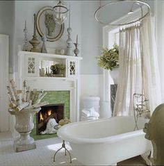 Vintage-Style Bathtub. I like the shower curtain attached. Imagine room lit with candles :)