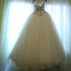 Fiore couture ballgown wedding dress Stunning Fiore Couture dress called the Aspen/Angelina. Pre-owned. Needs light cleaning but no yellowing of the stones and in excellent condition. Fiore Couture Dresses