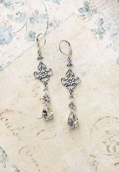 Crystal Glass Earrings Vintage Glass Antique Silver Filigree Fleur Long Dangle Earrings Bridesmaids Bride Wedding Accessories Shabby Country by apocketofposies on Etsy https://www.etsy.com/listing/117627557/crystal-glass-earrings-vintage-glass