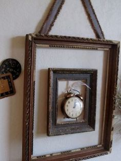 Since I have a few various-sized vintage clock and clock faces, I decided to stagger them to see how it would look...