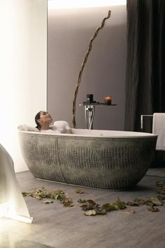 Bathtub encased in crocodile embossed leather.  A mere $22,086.00.  Let me get my checkbook . . .  (By PSCBATH)