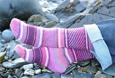 Fair Isle Swirl Socks - Two colours of Artesano Alpaca 4ply for the plain stripes. The paler pink is Sweet Pea CA13 and the darker magenta is Venezuela 4345. Main yarn is Crystal Palace Sausalito - Hibiscus 8309