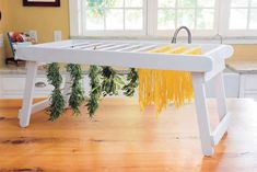 Use your noodle to build this DIY drying rack for hanging homemade pasta, herbs, dish towels and anything else you come up with. The folding rack won't take up valuable counter space when not in use. Pasta Drying Rack, Herb Drying Racks, Drying Rack Laundry, Drying Herbs, Wood Putty, Small Laundry Rooms, Laundry Closet, Mother Earth News, Homemade Pasta