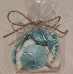 Beach Décor, Beach Wedding Décor, Shells, Starfish, Sea Urchins.  You have three options:  Option 1. You can either purchase a set of 6 Turquoise painted real sea creatures, which include 3 different starfish, 1 sand dollar, 1 sea biscuit and one sea urchin.  Option 2. A beautiful gift bag containing a mixture of 12 unpainted white shells, 3 different real starfish, 1 sea urchin, 1 sea biscuit and 1 sand dollar that have been painted in a Turquoise pearl paint. Option 3. A mixture of 12…