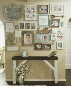 Wall Gallery entry Farmhouse style entry table. Shabby chic distressed white chalk paint with dark stained top. Gallery picture wall. Cotton stems complete the look.