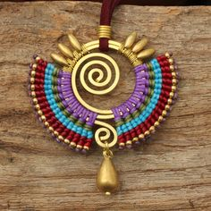 Woven cotton tribal pendant with hand shaped brass highlights