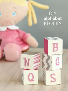 DIY alphabet blocks made with scrapbook paper and Mod Podge - perfect decor for a kids' room!