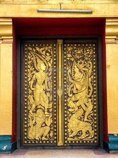 A golden decorated doorway at Wat Si Saket Buddhist temple. Vientiane, Laos. 27th March, 2015.