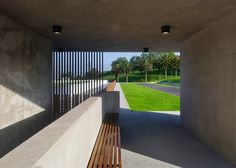AE Arquitectos has combined exposed concrete, white render and slatted timber for this morgue in Spain's Asturias principality