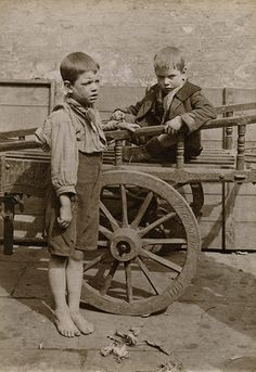 Credit: Horace Warner/The Religious Society of Friends in Britain Barefoot and carefree? Two boys play near a cart