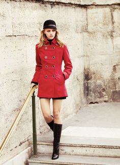 British Military Chic: Black Shorts. Red Military Jacket. Back Round Hat. Black Knee High Boots.